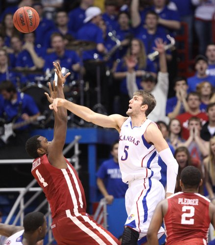 Kansas center Jeff Withey rejects a shot by Oklahoma forward Andrew Fitzgerald during the second half on Wednesday, February 1, 2012 at Allen Fieldhouse.
