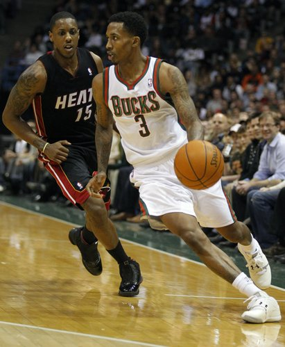 Milwaukee Bucks' Brandon Jennings (3) drives against Miami Heat's Mario Chalmers (15) during the second half of an NBA basketball game on Wednesday, Feb. 1, 2012, in Milwaukee. The Bucks won 105-97.