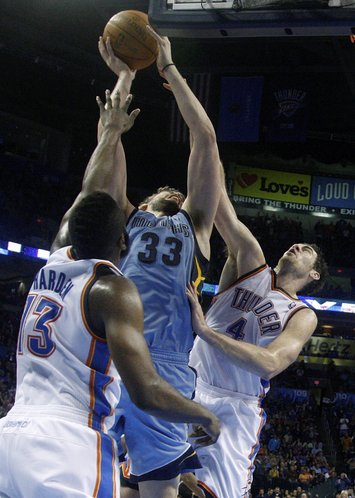 Memphis Grizzlies center Marc Gasol (33), of Spain, shoots between Oklahoma City Thunder guard James Harden (13) and center Nick Collison (4) in the fourth quarter of an NBA basketball game in Oklahoma City, Friday, Feb. 3, 2012. Oklahoma City won 101-94.