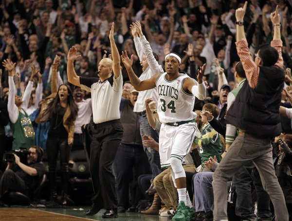 Boston Celtics' Paul Pierce celebrates with fans during the second half of Boston's 91-89 win over the New York Knicks in an NBA basketball game in Boston on Friday, Feb. 3, 2012.