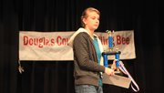 Emma Steimle, of West Middle School, was named the winner in the Douglas County Spelling Bee at Southwest Middle School on Saturday, Feb. 4, 2012..