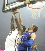 Kansas center Jeff Withey blocks a shot by Missouri forward Ricardo Ratliffe during the first half on Saturday, Feb. 4, 2012 at Mizzou Arena.