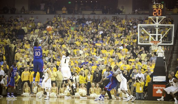 Kansas guard Tyshawn Taylor puts up a three over Missouri guard Phil Pressey during the first half on Saturday, Feb. 4, 2012 at Mizzou Arena.