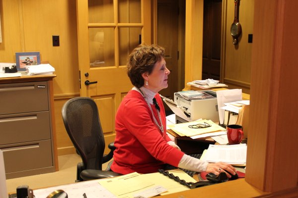 Kathy Underwood, executive assistant, not only was sporting red Friday, but drinking out of a red cup!