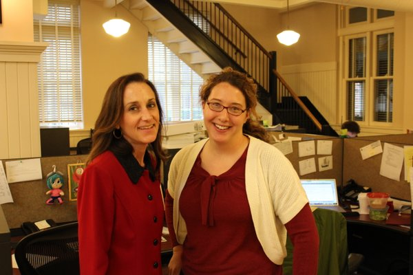 Reporters Karrey Britt, left, and Christine Metz — ladies in red.