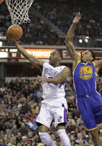 Sacramento Kings guard Marcus Thornton, left, drives to the basket past Golden State Warriors guardBrandon Rush during the fourth quarter of an NBA basketball game in Sacramento, Calif., Saturday, Feb. 4, 2012. The Kings won in overtime 114-106.