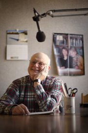 "Chuck Fisher, a 38-year Audio Reader volunteer, is pictured on Feb. 6 inside a studio. Fisher, who grew up in Lawrence, says he used to read to his grandfather on weekends when he was in high school. ""I guess I'm still reading for him in some way,"" Fisher said."