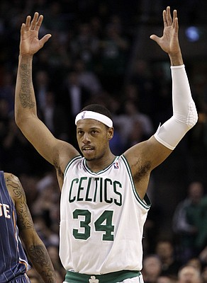 Boston Celtics forward Paul Pierce acknowledges the crowd after passing Larry Bird for the No. 2 spot on the team's career scoring list, during the second half of an NBA basketball game against the Charlotte Bobcats in Boston on Tuesday, Feb. 7, 2012.