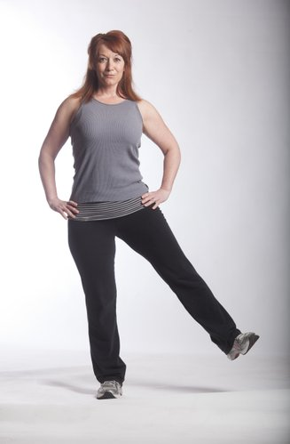 Personal trainer Jen Osborn demonstrates a basic leg lift.