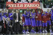 Thomas Robinson, center, and the KU bench cheer the Jayhawks as they make a comeback in the first half of the Jayhawks game against the Baylor Bears, Wednesday, Feb. 8, 2012 at Baylor.