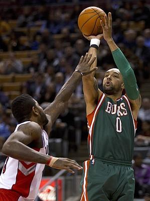 Milwaukee Bucks forward Drew Gooden shoots as Toronto Raptors forward Amir Johnson defends during the first half of an NBA basketball game in Toronto on Wednesday, Feb. 8, 2012.