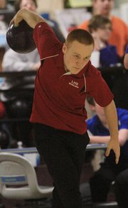 LHS' Austin Bennett competes during the Lions' Senior Night on Thursday, Feb. 9, 2012, at Royal Crest Lanes.