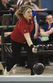 Lawrence High's Brooke Thornton looks for a strike on Thursday, Feb. 9, 2012, at Royal Crest Lanes.