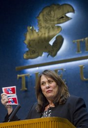 "Candy Crowley, CNN&squot;s award-winning chief political correspondent and anchor of ""State of the Union with Candy Crowley,"" jokes with the audience about her Jayhawk tissues she received in gift bag from KU. Crowley, who was battling a cold, spoke Friday at KU after receiving the 2012 William Allen White National Citation."