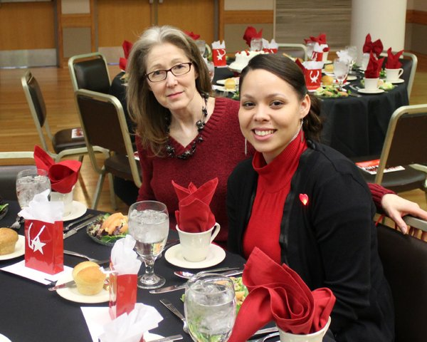 Sue Cassen, left, and April Reynolds, employees of Cardovascular Specialists of Lawrence, attend the annual Go Red For Women Luncheon & Expo Friday, Feb. 10, 2012, in Kansas Memorial Union's ballroom.