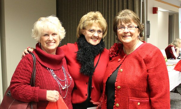 From left, Mary Jones, Janet Huss and Connie Rockers, all of Lawrence, attend the Go Red For Women Luncheon and Expo. They were among about 200 people who attended the event, which raises money for the American Heart Association.