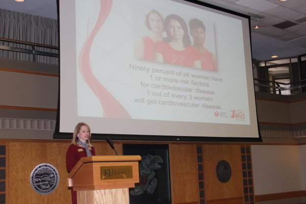 Kirsten Flory, co-chair of the Go Red For Women Luncheon and Expo, talks about heart health during the program. About 200 people attended the event which raised money for the American Heart Association.