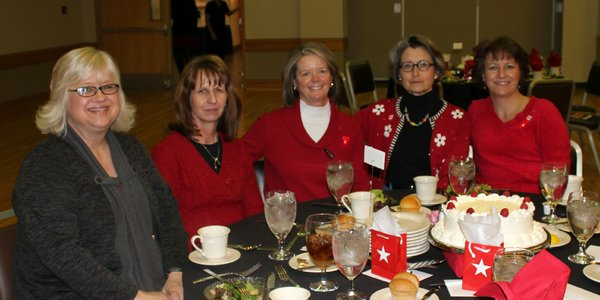 From left are Mary Jo Williams, Teresa Mock, Michelle Derusseau, Kathy Sanders and Lori Blaylock. They attended the 2012 Go Red For Women Luncheon and Expo. Derusseau was the keynote speaker at the event in 2011. She suffered a heart attack at age 39.