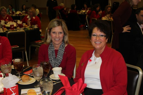 Jennifer Cook, left, Lawrence, and Cindy Ford, Shawnee, attend the 2012 Go Red For Women Luncheon and Expo.
