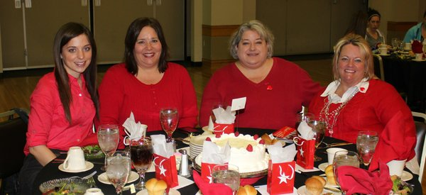 From left, Kylene Etzel, Linda Jalenak, Lori Madaus and Kim Iles attend the Go Red For Women Luncheon and Expo in the KU Memorial Union ballroom. They served on the planning committee for the event.