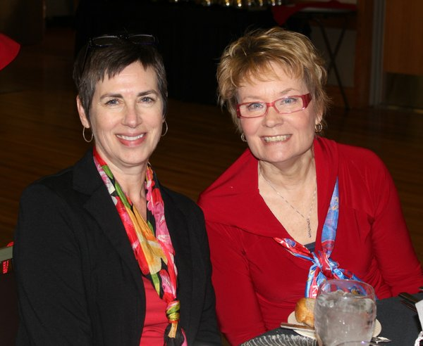 Laurie Comstock, left, and Pam Smith, of KU Endowment, attend the Go Red For Women Luncheon and Expo on Friday, Feb. 10, 2012, in the KU Memorial Union ballroom.