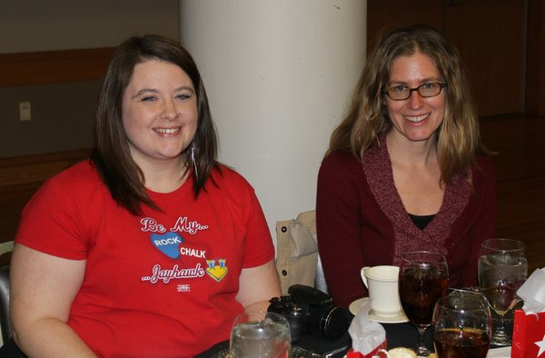Sara Brummer, left, and Jennifer Church, employees of the Lawrence-Douglas County Health Department attend the 2012 Go Red For Women Luncheon and Expo, which was a fundraiser for the American Heart Association.