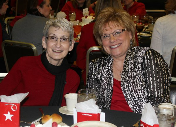 Judy Eldridge, left, and Debbie Schmidt attend the Go Red For Women Luncheon and Expo on Friday, Feb. 10, 2012, in the KU Memorial Union ballroom. The event raised awareness about heart disease and money for the American Heart Association.