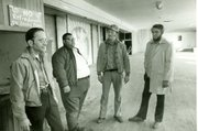 Founders of the Lawrence Boys' Club, Bob Wells and Bobby Lee and other community members survey the space for the club in this 1973 photo. The boys club was first housed on the third floor of a building that stood at 10th and Mass St.