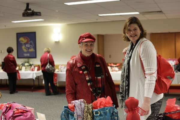 Donna McCain, left, and Kay Traver, both of Lawrence, attend the Go Red For Women luncheon benefit for the American Heart Association Friday, Feb. 10, 2012, at the Kansas Union Ballroom.