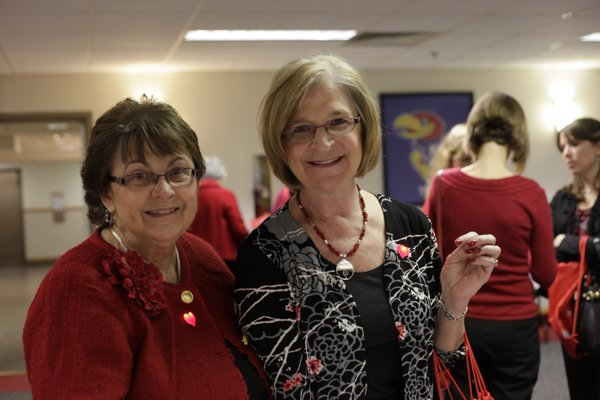 Connie Rockers, left, and Deborah Kurtz attend the Go Red For Women luncheon benefit for the American Heart Association Friday, Feb. 10, 2012, at the Kansas Union Ballroom.