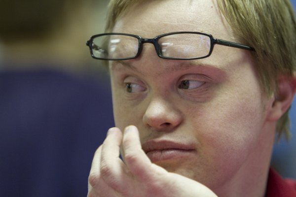 Grant Miller, 26, Lawrence, who has Down syndrome, lives independently thanks to services that are funded through Medicaid. Advocates fear that the state's plan to privatize Medicaid will disrupt services for individuals with developmental disabilities, like Grant, who depend on them for daily living.