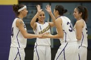 Haskell's four graduating seniors, from left, Sharon Forte, Nataska Rouse (1), Lois Stevens (30), and Kayla Davis celebrate before the start of their last home game together Saturday, Feb. 11, 2012 at Coffin Complex.