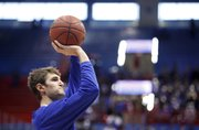 Kansas center Jeff Withey puts up a shot prior to tipoff against Oklahoma State on Saturday, Feb. 11, 2012 at Allen Fieldhouse.