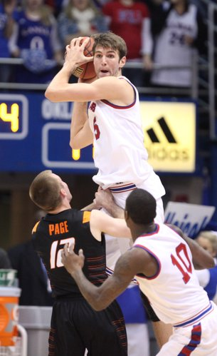 Kansas center Jeff Withey looks for an outlet after rejecting a shot by Oklahoma State guard Keiton Page during the first half on Saturday, Feb. 11, 2012 at Allen Fieldhouse.