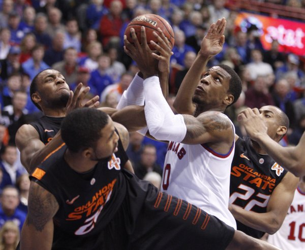 Kansas forward Thomas Robinson wrestles for a rebound amidst the Oklahoma State defense during the first half on Saturday, Feb. 11, 2012 at Allen Fieldhouse.