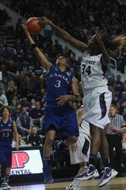 Kansas State's Branshea Brown blocks a shot by Kansas' Angel Goodrich in the first half on Sunday Feb. 12, 2012.