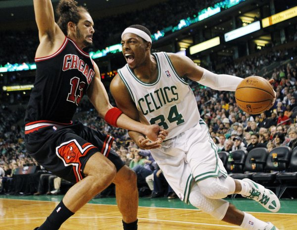 Boston Celtics' Paul Pierce (34) drives past Chicago Bulls' Joakim Noah (13) in the first quarter of an NBA basketball game in Boston, Sunday, Feb. 12, 2012.