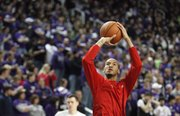 Kansas guard Travis Releford puts up a shot during warmups prior to tipoff against Kansas State on Monday, Feb. 13, 2012 at Bramlage Coliseum.