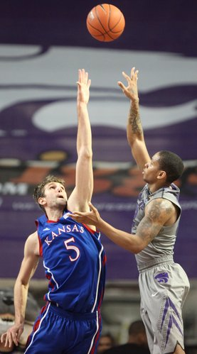 Kansas State forward Rodney McGruder lofts a shot over Kansas center Jeff Withey during the first half on Monday, Feb. 13, 2012 at Bramlage Coliseum.