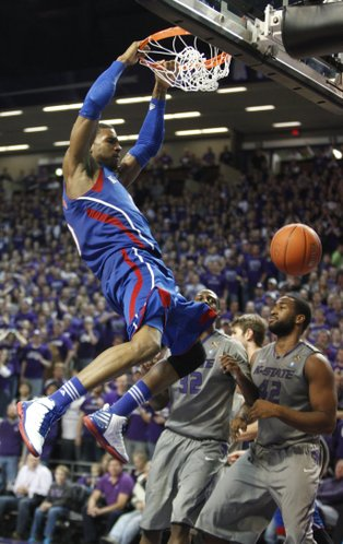 Kansas forward Thomas Robinson delivers a dunk before Kansas State players Thomas Gipson (42) and Jamar Samuels (32) during the second half on Monday, Feb. 13, 2012 at Bramlage Coliseum.