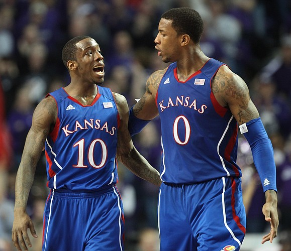 Kansas teammates Tyshawn Taylor (10) and Thomas Robinson try to calm each other during a Kansas State run in the second half on Monday, Feb. 13, 2012 at Bramlage Coliseum.