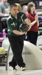 Free State's Jordan Jump concentrates on his delivery during the crosstown bowling matchup between FSHS and Lawrence High on Tuesday, Feb. 14, 2012, at Royal Crest Lanes.
