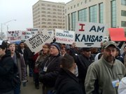 Crowd rallies on Wednesday in opposition to immigration and voting policies of Kansas Secretary of State Kris Kobach.