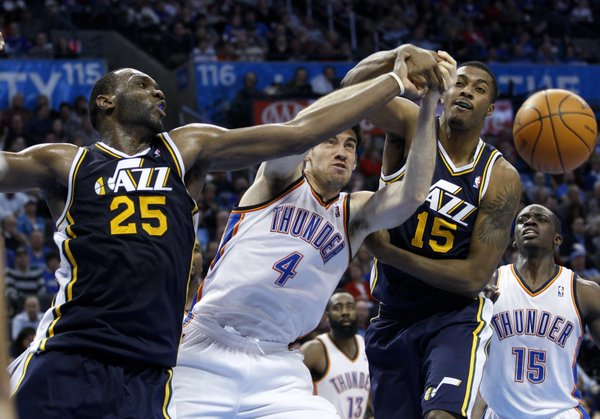 Utah Jazz center Al Jefferson (25), Oklahoma City Thunder center Nick Collison (4) and Jazz forward Derrick Favors (15) reach for a rebound in the third quarter of an NBA basketball game in Oklahoma City, Tuesday, Feb. 14, 2012. Oklahoma City won 111-85. Oklahoma City won 111-85.
