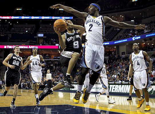 San Antonio Spurs guard Tony Parker (9), of France, shoots past Memphis Grizzlies guard Josh Selby (2) in the second half of an NBA basketball game on Monday, Jan. 30, 2012, in Memphis, Tenn. The Spurs won 83-73.