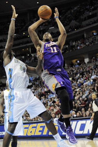 Phoenix Suns forward Markieff Morris (11) shoots against Denver Nuggets forward Kenneth Faried (35) during the second quarter of an NBA basketball game on Tuesday, Feb. 14, 2012, in Denver.