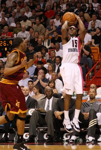 Mario Chalmers shoots over Alonzo Gee during the second quarter of the Cleveland Cavaliers vs. Miami Heat game at the AmericanAirlines Arena in Miami on Feb. 7, 2012.