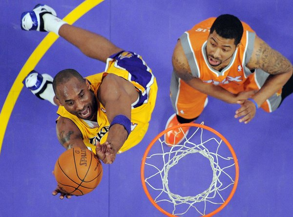 Los Angeles Lakers guard Kobe Bryant, left, shoots as Phoenix Suns forward Markieff Morris defends during the first half of their NBA basketball game, Friday, Feb. 17, 2012, in Los Angeles.