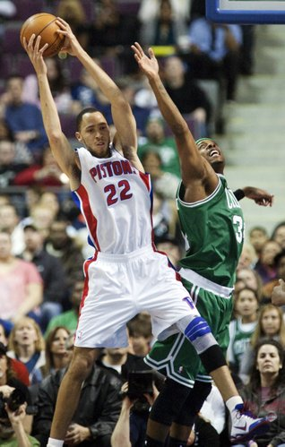 Detroit Pistons' Tayshaun Prince (22) grabs a rebound away from Boston Celtics' Paul Pierce in the first half of an NBA basketball game, Sunday, Feb. 19, 2012, in Auburn Hills, Mich.