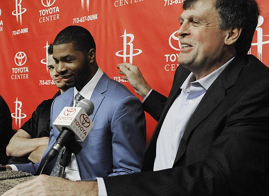 Houston Rockets basketball coach Kevin McHale, right, introduces the team' first round NBA draft pick Kansas forward Marcus Morris during a news conference, Friday, June 24, 2011, in Houston.